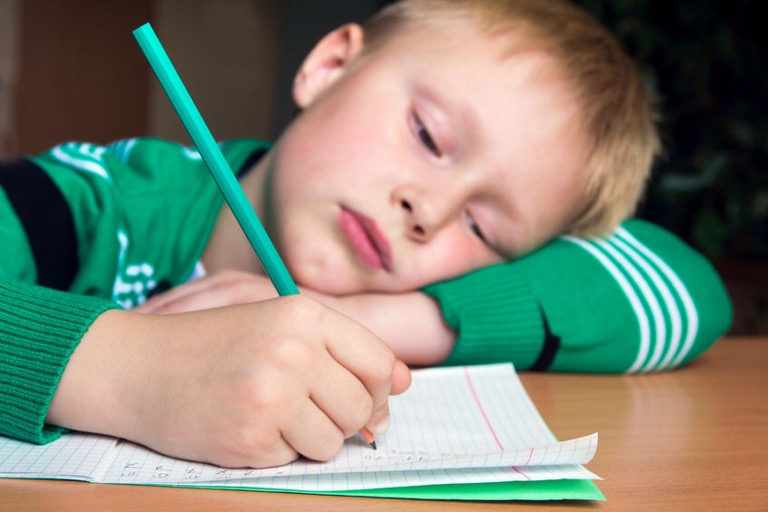 47033797 - tired boring boy doing his difficult school homework